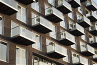 377 clear custom glass, structural balconies in Baltimore Wharf, London docklands, a problem solved by Balcony Systems.
