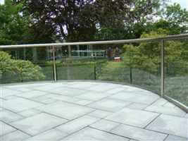 Wide curved balustrade with Royal Chrome handrails and beautiful garden views