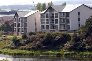 Large building on the river with silver balustrades