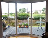 Curved Glass Sliding Doors make all the difference at refurbished South Wales property