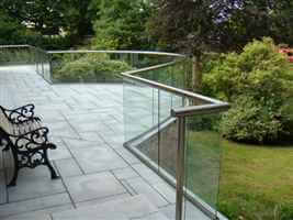 Curved and straight canalside balcony with a bench to sit on and look over the gardens