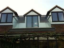 Glass Balustrade with Royal Chrome handrail in Surrey