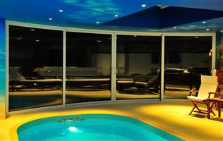 Poolside curved doors in Herts inside at night
