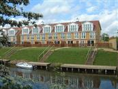 Exclusive townhouses overlooking the River Nene are enhanced by the added Clear Glass Juliet Balconies.