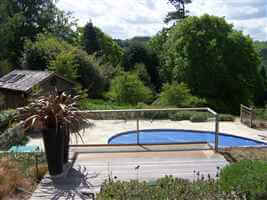 Silver balustrade over looking pool