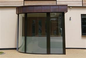 curved entrance glazing with frosted glass