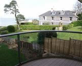 iPad winning views from Royal Chrome Clear Glass Balustrade overlooking the Solent from this Isle of Wight property