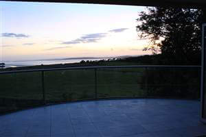 Royal Chrome curved balcony in the evening with beautiful sea view in the distance