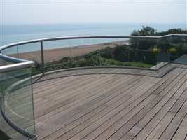 Curved balcony 1 silver balustrade with the view of the beach and the sea with blue sky