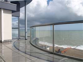 Curved Royal Chrome balustrade overlooking the seaside