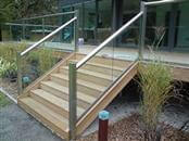 Glass balustrade systems for stairs are modern, safe and on-trend. Read about the internal and external systems available in glass balustrading for stairs!