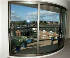 Balcony curved patio door curving inwards