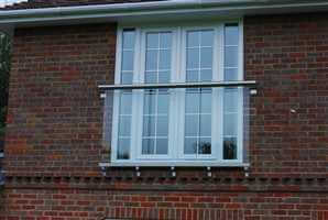 Juliet balcony on brick house with Royal Chrome handrail