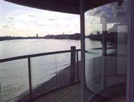 Curved balcony 1 silver balustrade with a view of the Thames