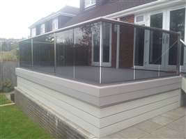 Tinted glass balcony with Royal Chrome handrails and Composite Decking