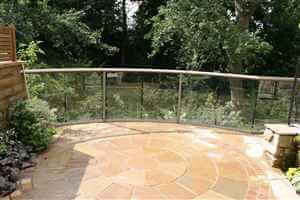 Bronze balcony 1 curved balustrade with detailed patio and garden with trees