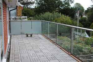 Royal Chrome balcony with frosted glass sides for privacy