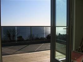 Beautiful views of the coast from a bronze balcony with grey tinted glass