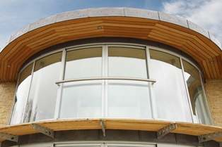 Curved Glass Windows with Curved Juliet balcony