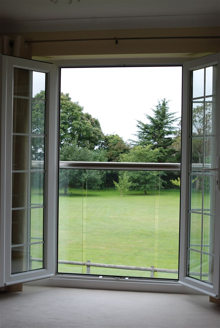 Garden view from a Royal Chrome Orbit Juliet Balcony