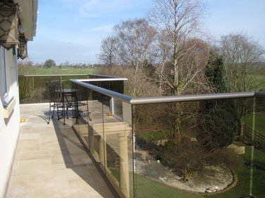 Tinted Glass Balcony with Bronze handrail