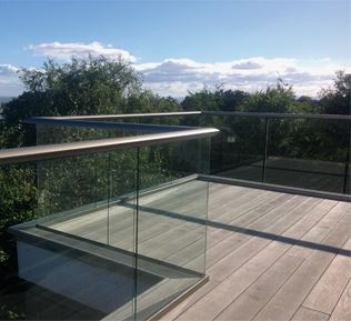 Bronze Aerofoil Glass Balustrade with Golden Oak Composite Decking