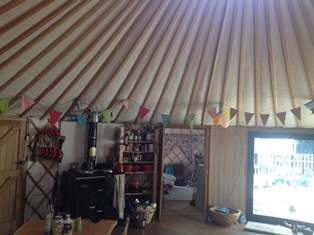 Curved Glass Sliding Doors in a Yurt