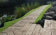Non-rot plastic decking board for wetland areas