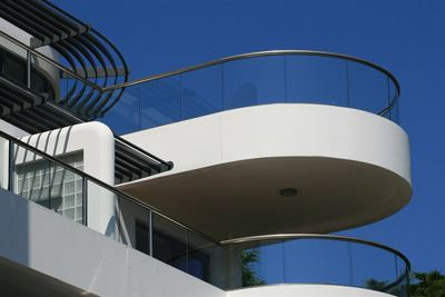 Curved Semi-Frameless Royal Chrome Glass Balustrading surrounded by blue skies.