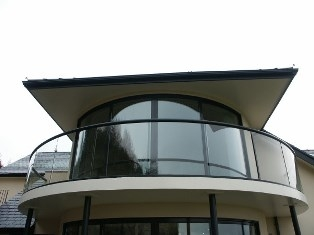 Curved Sliding Doors with curved glass balustrade