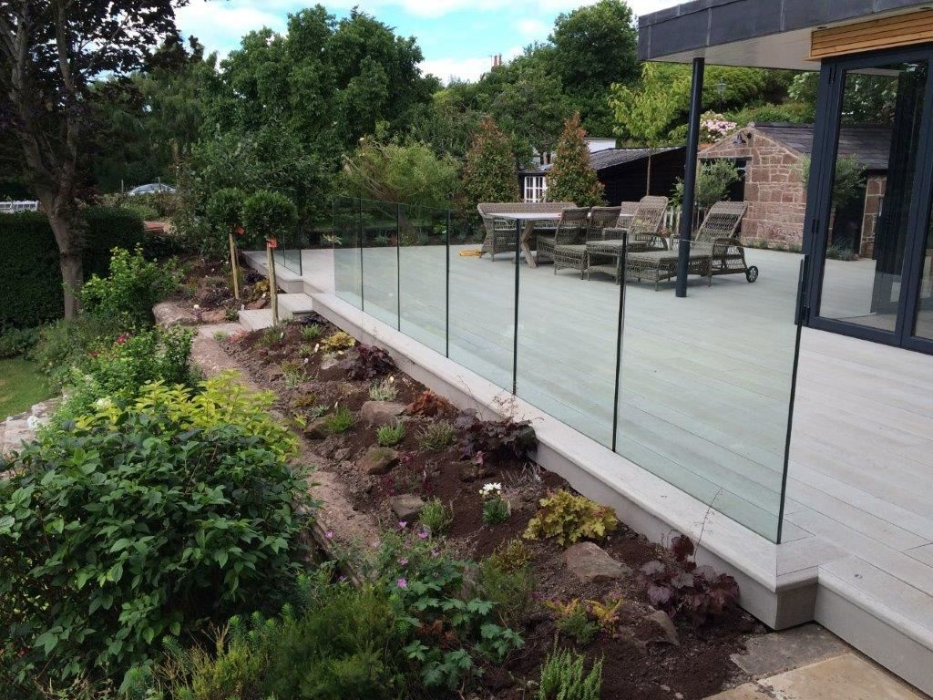 Frameless glass balustrade below floor level