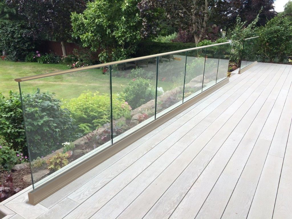 Frameless glass balustrade with top rail above floor level