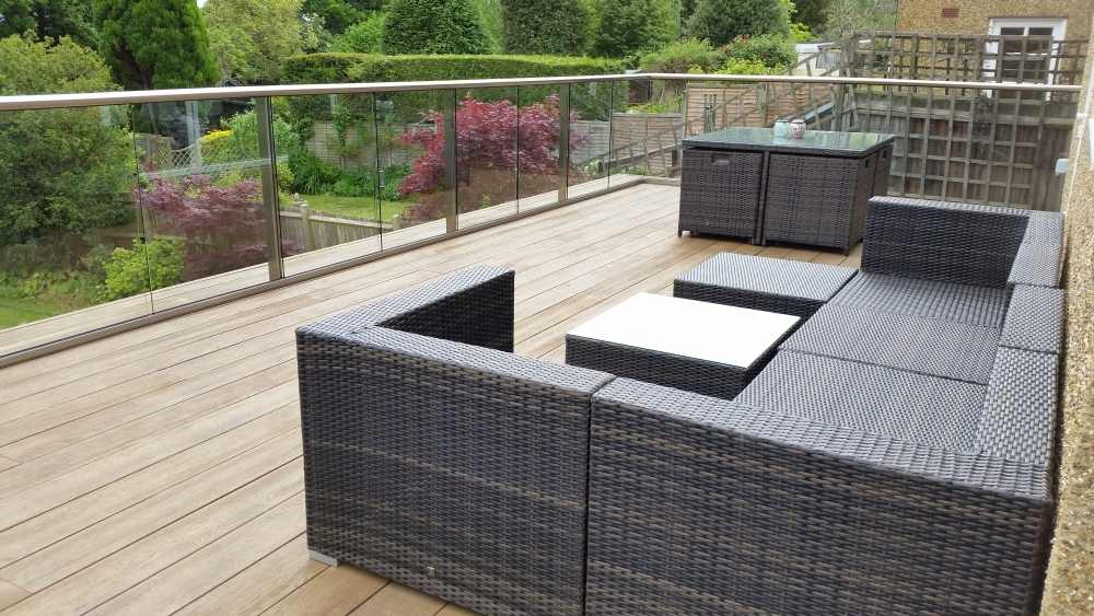 Balustrade composite decking surrey case study for Garden decking glass panels