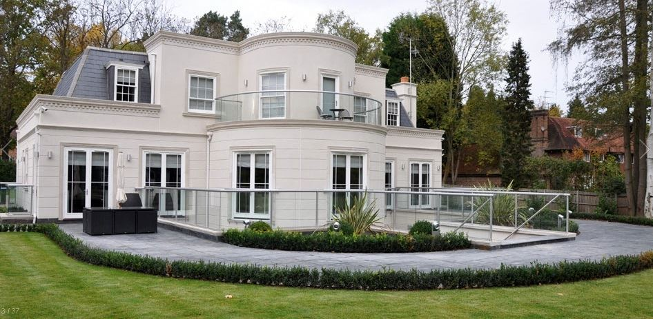Silver Orbit Glass Balustrade installed on a grand white house