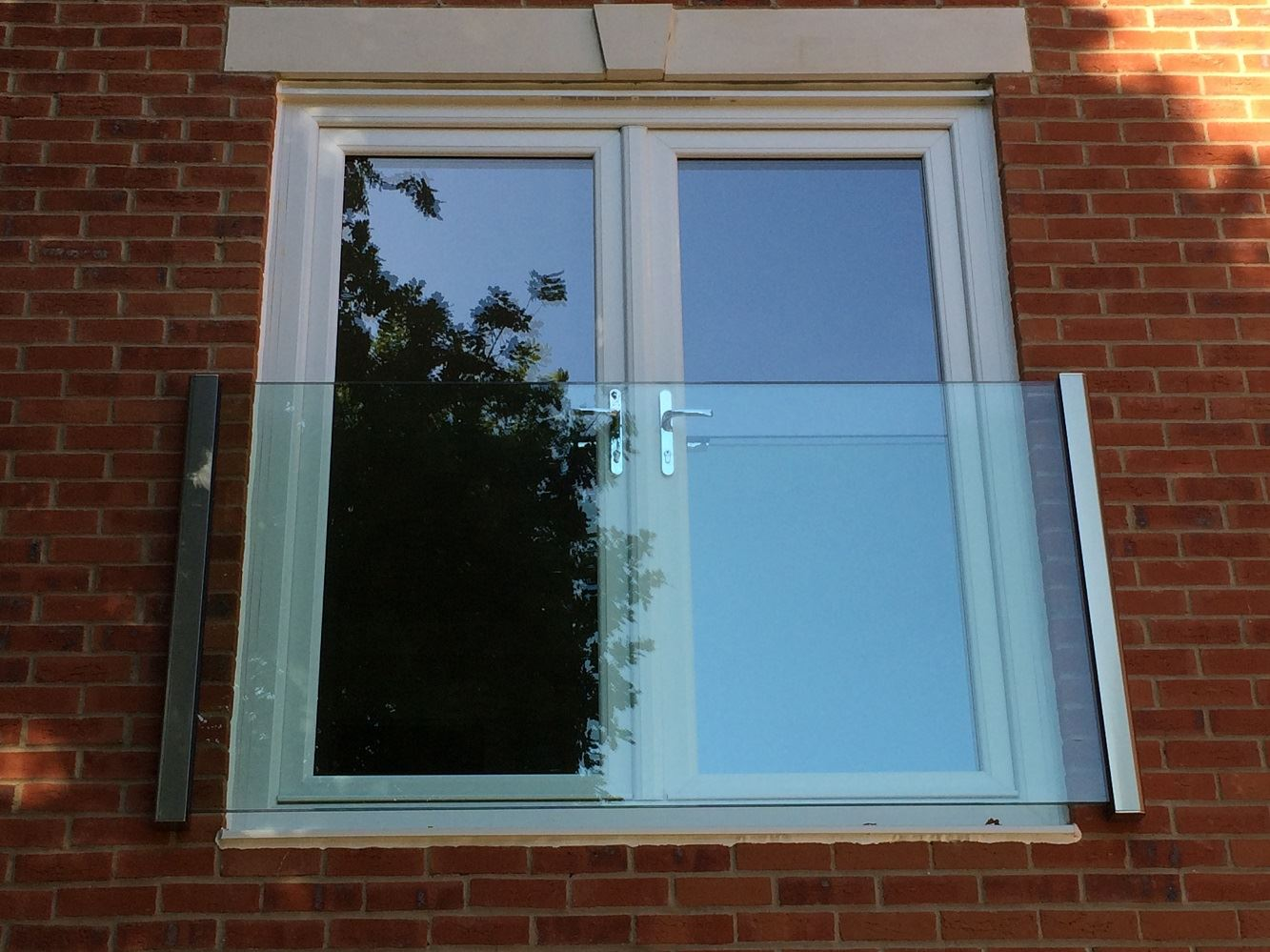 Frameless Juliet Balcony 2180mm wide in Royal Chrome