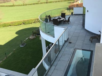 SG12 Frameless Balustrade with handrail overlooking the sunny Yorkshire countryside