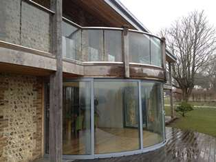 Curved Glass Sliding Doors and banister
