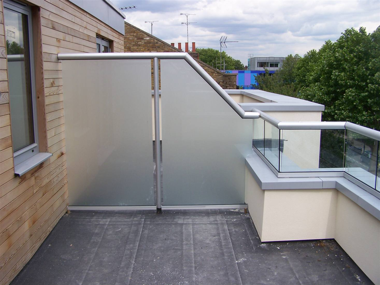 Balcony balustrades and glass privacy screens for Apartment balcony privacy solutions