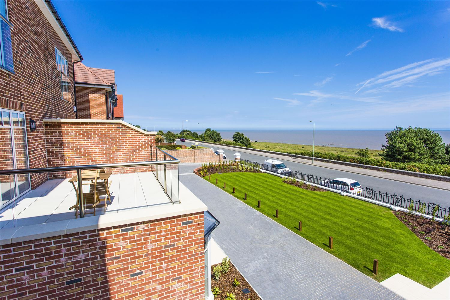 Orbit Glass Balustrading installed on a three-storey luxury villa overlooking the sea at Gunton near Lowestoft