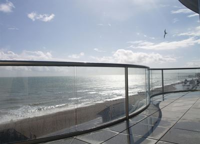 Royal Chrome Glass Balustrade overlooking the sea