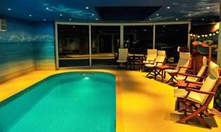 Curved Sliding Doors in pool room