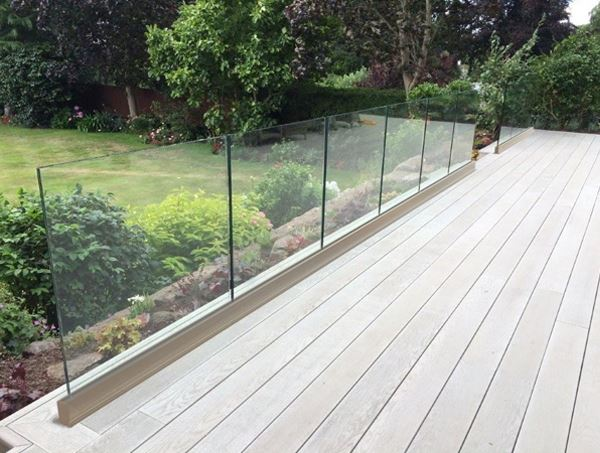 Frameless Glass Balustrade (fitted above floor level) with a beautiful garden view