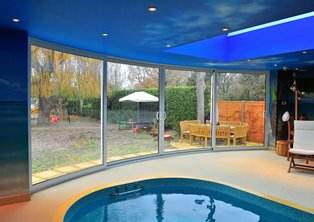 Curved Patio Doors in swimming pool room