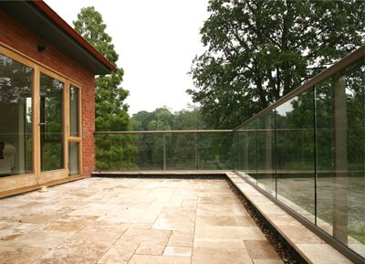 Bronze Aerofoil Glass Balustrade surrounded by trees
