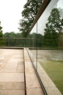 Glass Balcony with aerofoil handrail