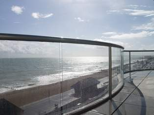 Curved Glass Balcony by the sea