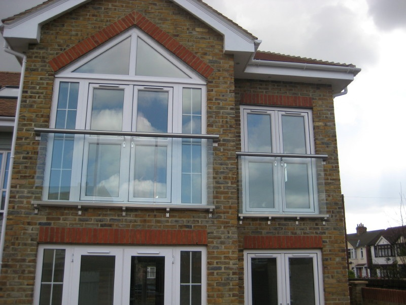 Glass balustrades juliet balconies curved glass for Balcony company